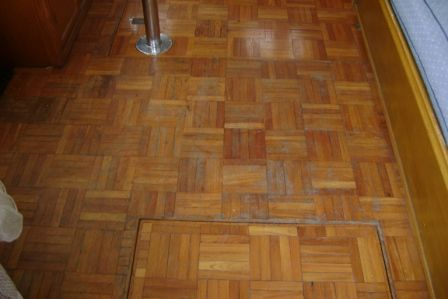 Teak parquet sole is sound but ready for refinishing.