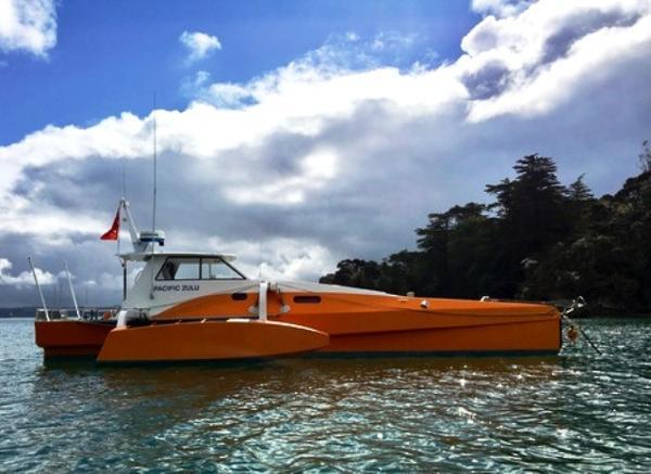 Custom Long Range Power Trimaran Pacific Zulu at anchor