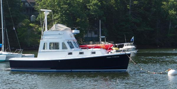 Webbers Cove 34 Flybridge Cruiser Side View