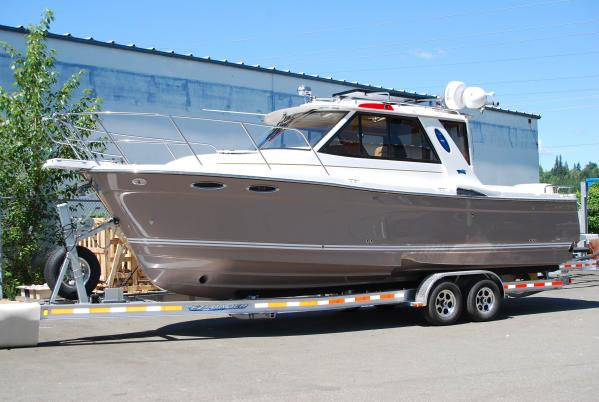Cutwater 28 With Trailer Sistership shown with optional EZ Loader Trailer