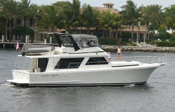 Canoe Cove Sedan Flybridge side profile full enclosed bridge extended hardtop over cockpit