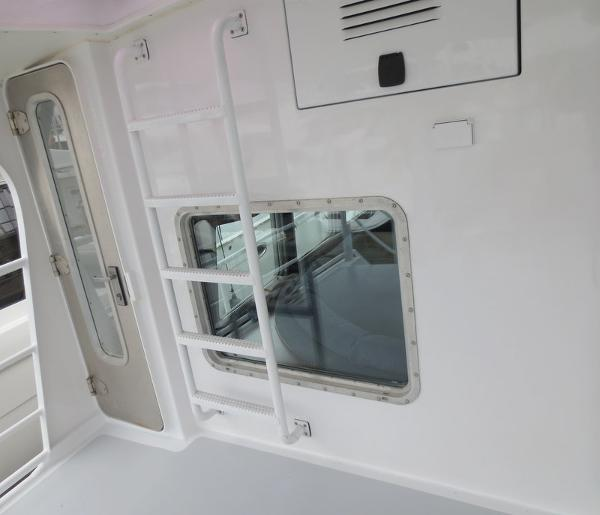 Bulkhead aft at platform area, entry door to port side walk around