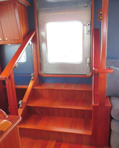 Stairway to and from vessel at main door entry aft deck area