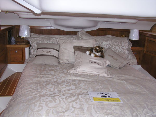 Owner's aft stateroom with queen-size inner spring mattress & custom-fitted sheets