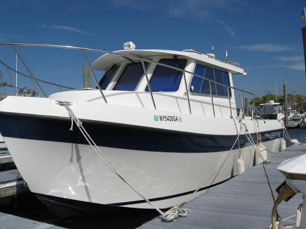 Osprey Pilothouse 28 Long Cabin Bow Signature