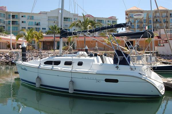 Hunter 290 Class B Sloop Side view w/Bimini