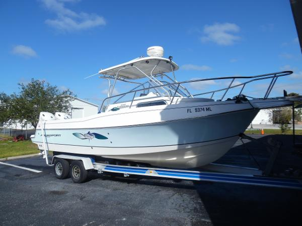 Aquasport 250 Explorer Starboard Side Forward On Trailer