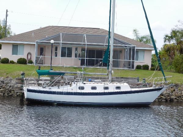 Navigator sloop Angels Wing at her home dock