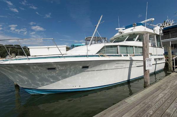 Bertram 46 Flybridge Motor Yacht At The Dock