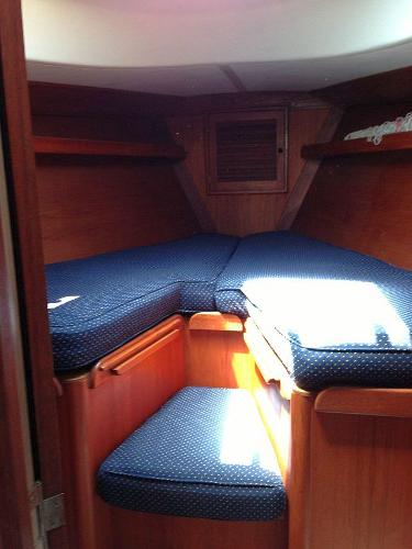 The forward stateroom; changing seat cushion raises to make a full width berth
