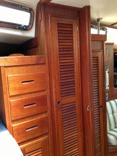 Drawer and hanging storage in the forward stateroom