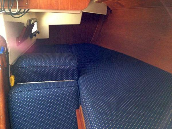 The seat from the nav can raise to a flat position for a full width berth