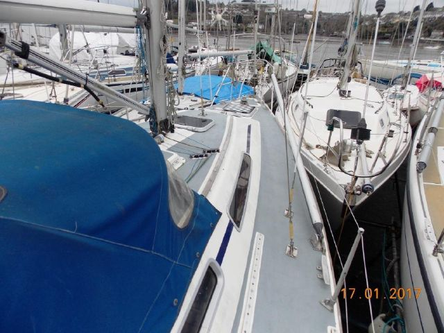 Spinnaker pole stowed on deck