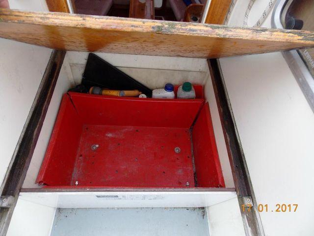 Storage under companionway