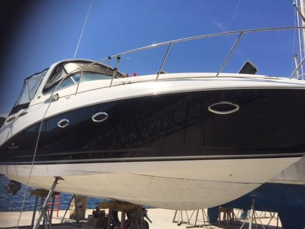 Rinker 350 Express Cruiser Blue hull finish.