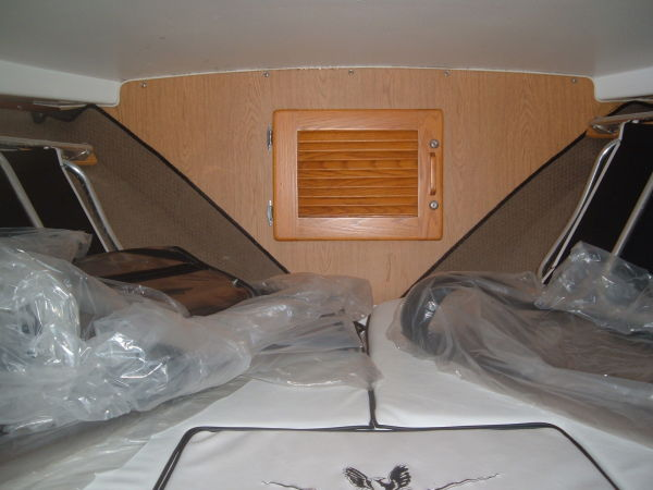 new canvas, stored in the V-berth