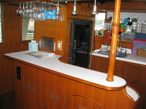 Galley bar with glass rack