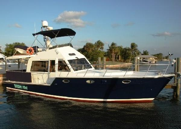 "Island Pilot 395 ""Fast"" Trawler With Two Cabins In A Slip"