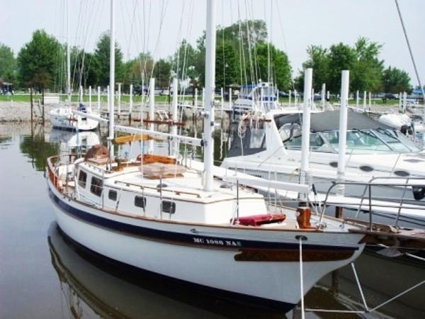 Tayana Mariner Ketch Dockside showing her traditional and timeless starboard profile.