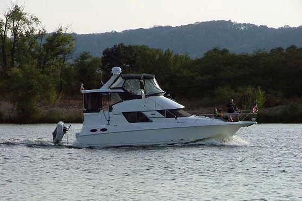 Silverton 392 Motor Yacht Underway with Dinghy