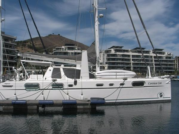 Catana 582 sailing catamaran Side view at mooring