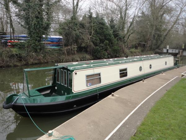 Moored in pound lock at entrance to River Wey