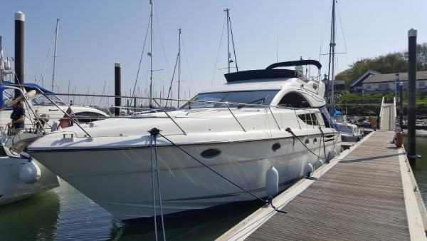 Fairline Phantom 50 Flybridge. Home marina alongside berth.