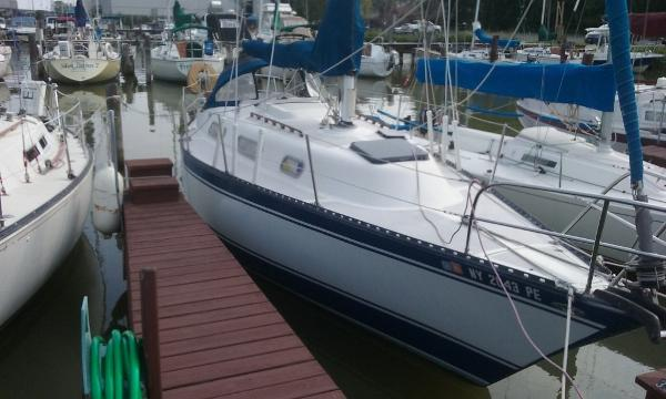 Hughes 31 Starboard at dock