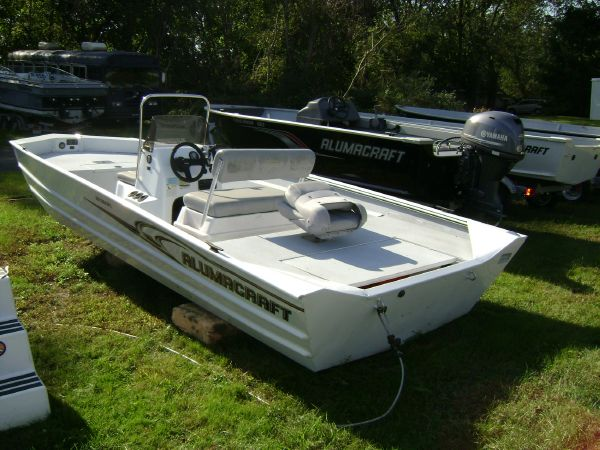 Boat with driver seat w/ cooler