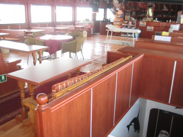 42 m Excursion vessel /Saloon facing the bar