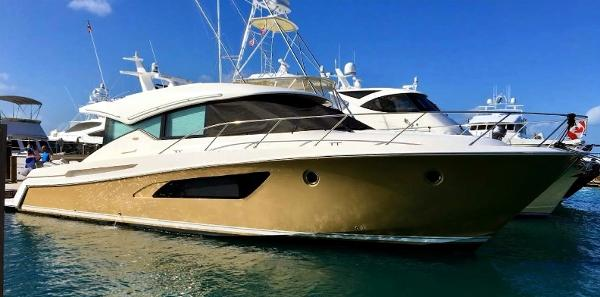 Tiara 50 Coupe Northern Answer at dock with optional desert sand hull