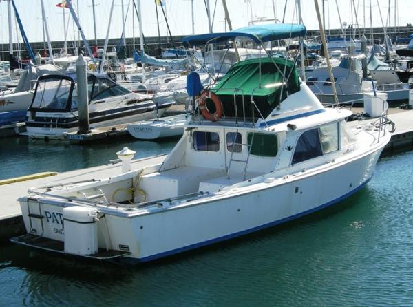 "Bertram 31 Flybridge Cruiser ""Patriot"" dockside"