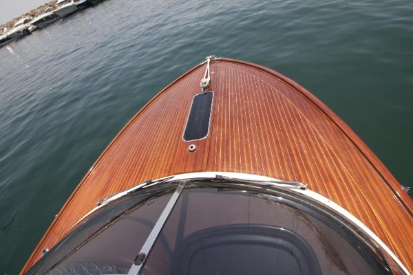 The fine quality teak decking bow and Mahogany rails..