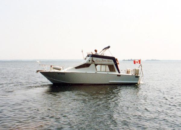 Glen L 8M Flybridge Sedan On the Water