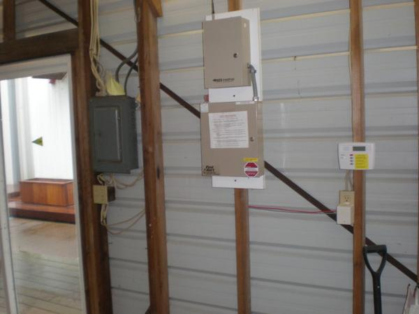 Remotely monitored alarm system and main electrical panel