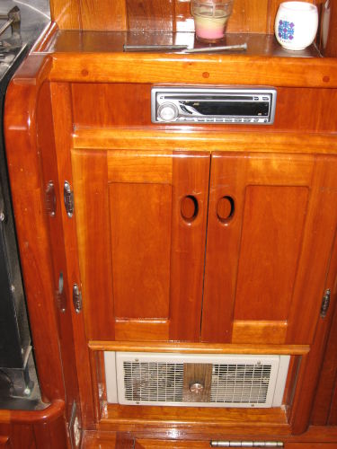 Stereo and liquor cabinet (note electric baseboard heater)