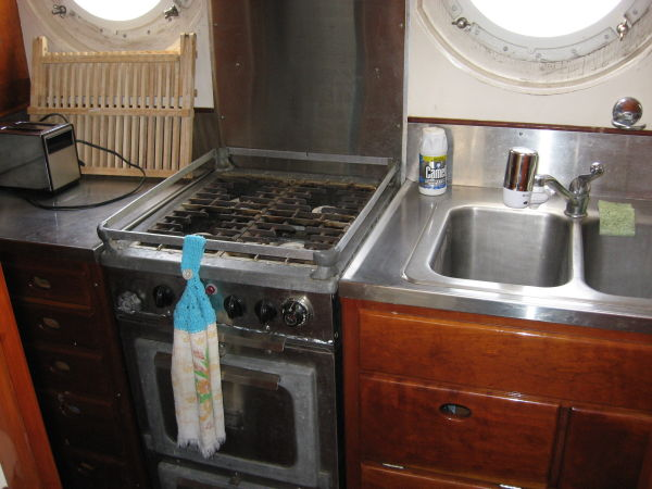 Galley sink, gas stove and oven with vent hood