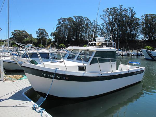 Osprey Pilothouse 24 Fisherman at the dock