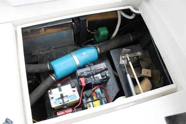 Batteries under Lift out tray to Starboard