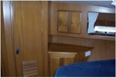 Forward guest cabin cabinetry to port
