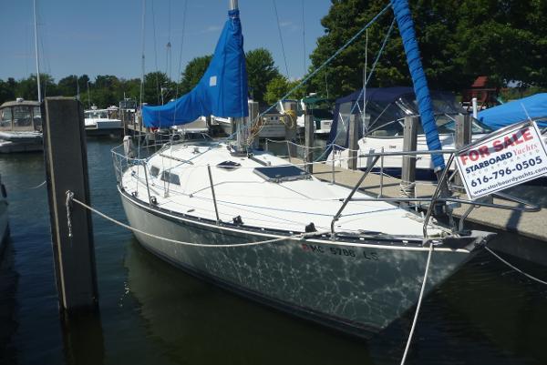 C&C Fiberglass Sailboat In the slip