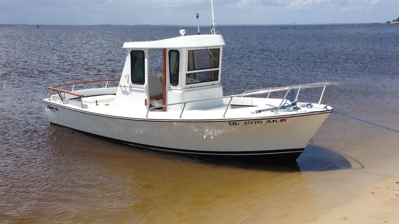 Shamrock Center Console / Pilot House Tuggy at the Beach.jpg