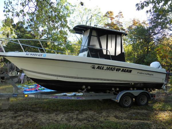 Fish Hawk 233 CC w ENCL AND TRAILER