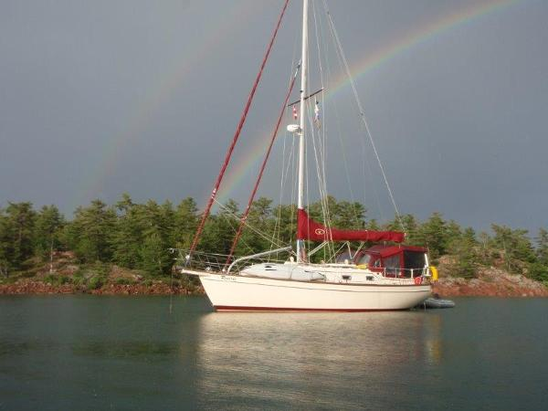 Island Packet 350 Double rainbow at anchor