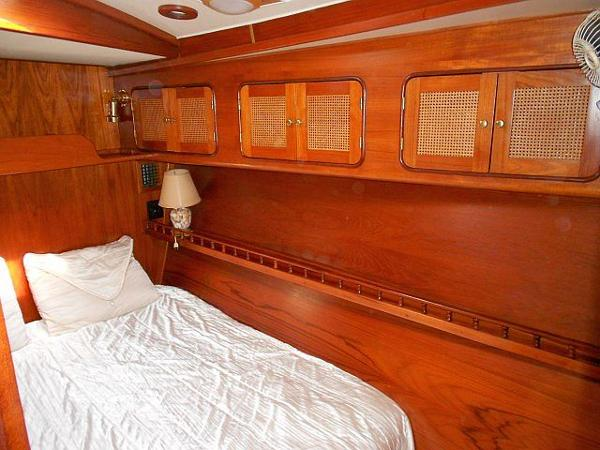 The midship stateroom features a double berth and plenty of storage