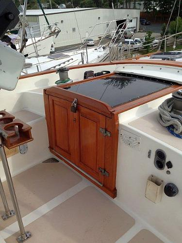 Bi-fold companionway doors stow out of the way