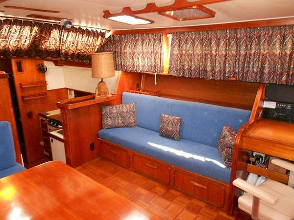 Starboard settee and steps down to the galley