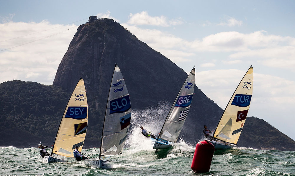 Finns and Sugarloaf mountain. 2016 Rio Olympic Games: Sailing: Photo Sailing Energy/World Sailing.