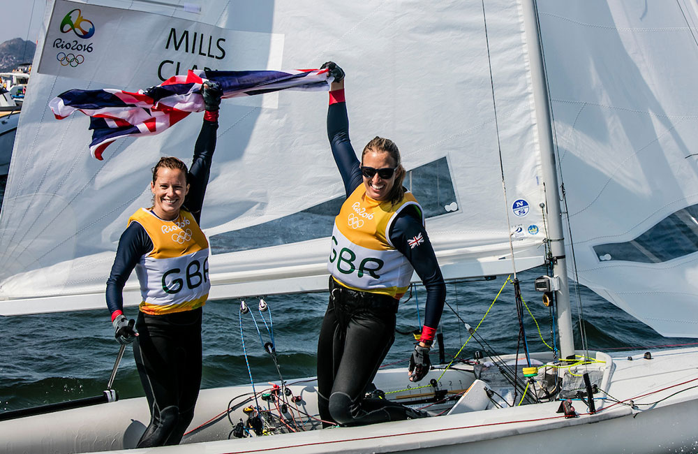 Hannah Mills Saskia Clark celebrate gold. 2016 Rio Olympic Games: Sailing: Photo Sailing Energy/World Sailing.