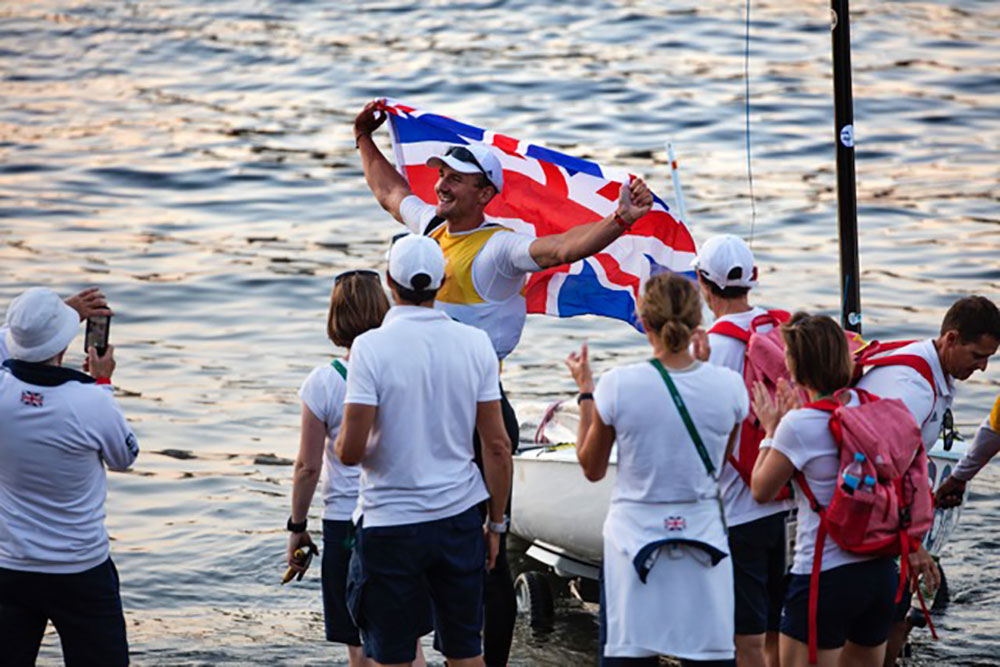 Giles Scott gold medal celebrations ashore Photo Richard Langdon/British Sailing Team.